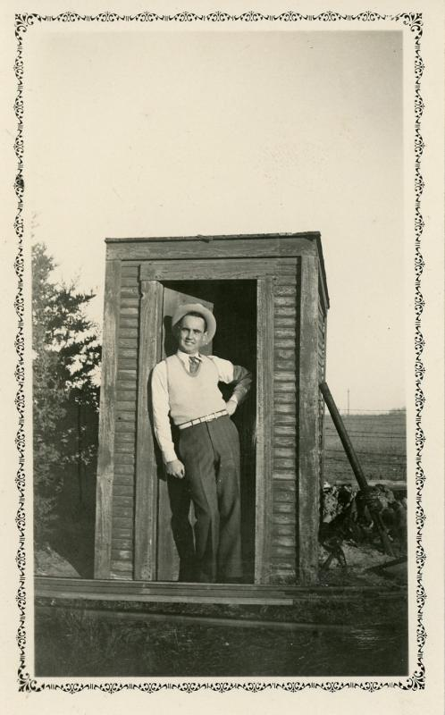 13 John Lauber in an outhouse 1930s Mary Dameron.jpg